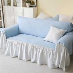 Oversized blue slipcover for sectional sofa with white base fabric whote accent pillow