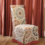 Parson Chair Slipcovers With Unique Pattern And Orange Curtain Behind