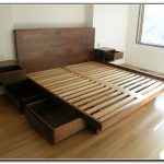 Platform Bed Frame Idea With Drawers And Wall Mounted Bedside Tables