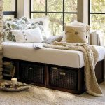 Pottery barn daybed with rattan boxes as the under storage space