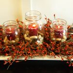Red Candles In Jars Surrounding Branch Fall Center Pieces