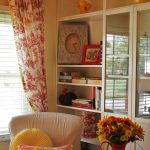 Red Toile Curtains Near Bookcase And Chair