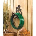 Ride-'em-cowboy-decorative-garden-hose-holder-with-cowboy-and-horse-on-the-saddle-design-and-made-of-cast-iron-mount-on-wooden-wall