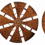 Robert-Jupe-original-design-of-expanding-round-table-with-8-pies-and-8-hidden-leaves