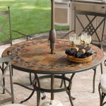 Round Patio Stone Table Near Garden