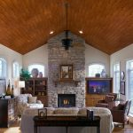 Rustic Home Design With Wood Ceiling Planks And Stone Fireplace