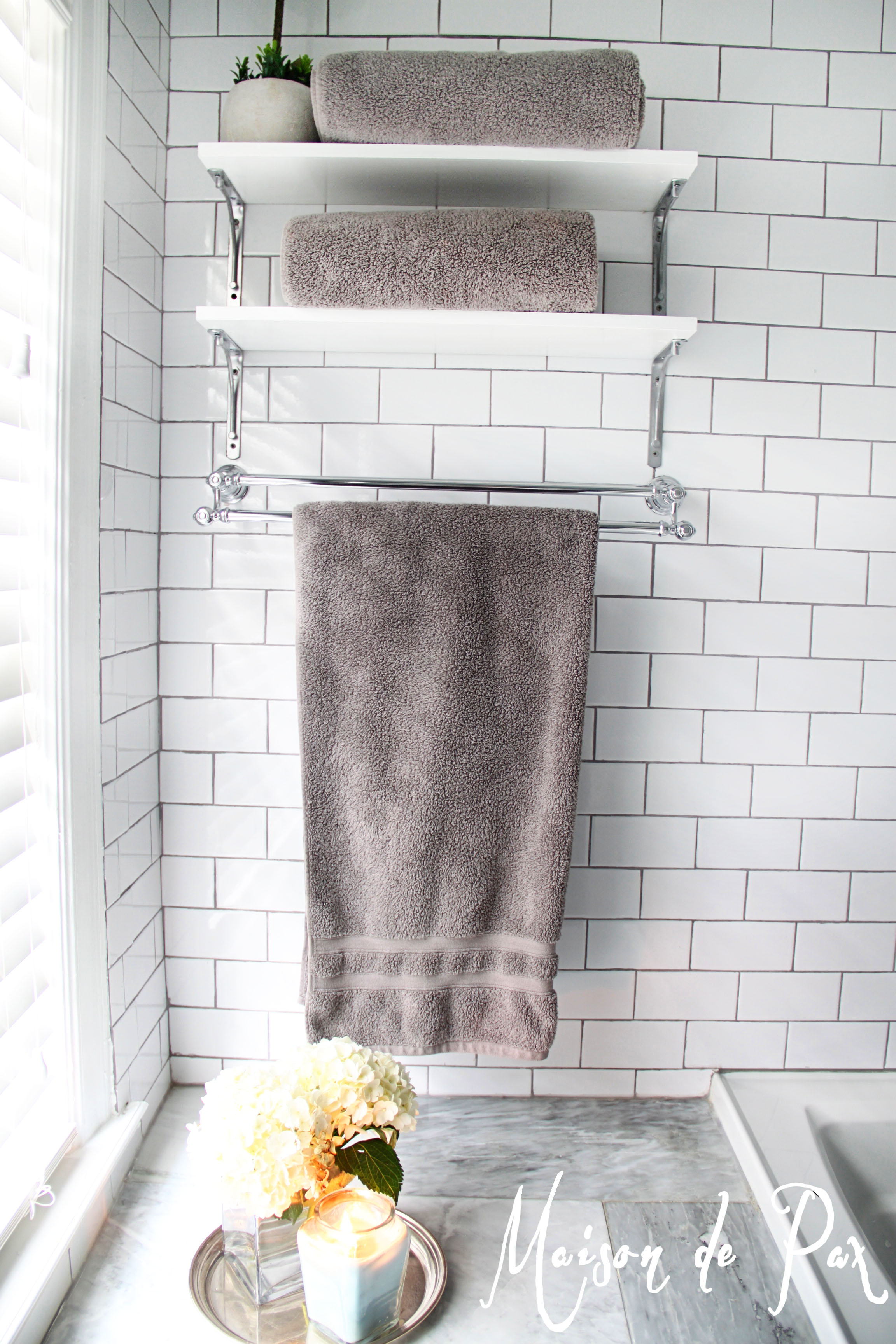 Complete your bathroom with storage for towel homesfeed for Bathroom ideas towels