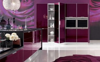 Side By Side Ovens In Purple Kitchen With Rose Wallpaper And Cool Pendant Lamp