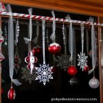 Silver And Red Ribbon With Ornaments For Christmas On Window With Wooden Frame
