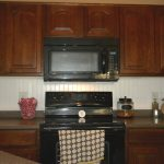 Simple Design Of Built In Stove Top Kitchen With Wooden Kitchen Set