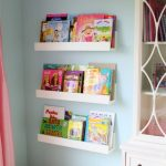 Simple Kid Bedrom With White Wall Shelves For Books