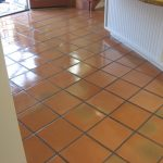 Simple Spanish tile floor idea in bright orange