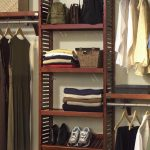 Simple clothes rack consisting of wall wooden rack for footwears bags and folded clothes shelves with rods floating shelf with rod and a box storage on its top