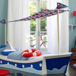 Sky Blue Nautical Bedroom WIth Blue Wall Paint And Standing Ship Design On Bed