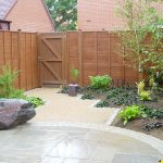 Small Backyard Garden Design Ideas With Fence And Sand Pathways