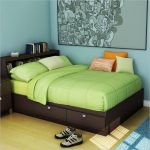 Standard sized bed frame with drawers and shelves in its headboard green bedding green duvet