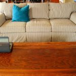 Strips slipcover for sectional sofa with blue accent pillow