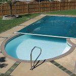 Swimming Pool With Cover Near Wooden Fence