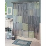 Unique fabric shower curtain  grey shower mat small sink and faucet white framed mirror