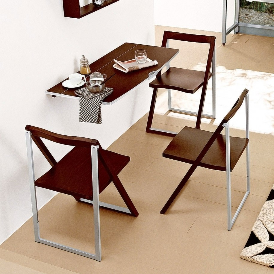 Folding dining table for small space - Wall Mounted Folding Dining Table With Triple Chairs On White Wall