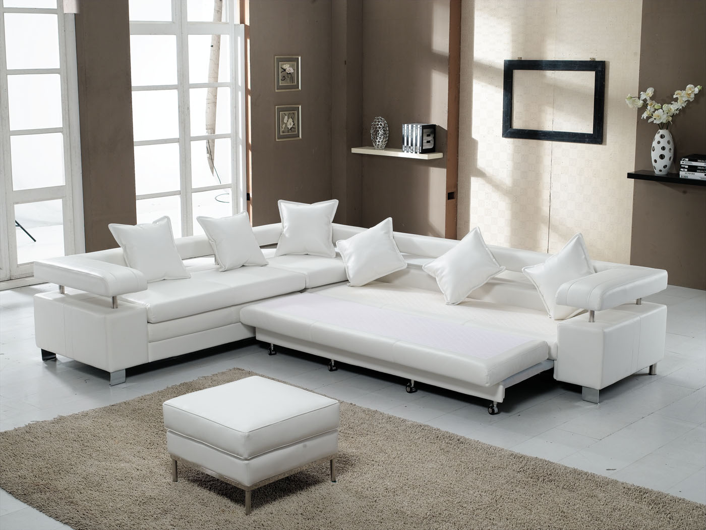 White Apartment Size Sleeper Sofa With Pillows And Fur Rug