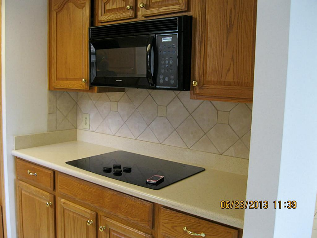 Built in stove top ideas homesfeed for Built in kitchen cupboards for a small kitchen