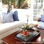 White Slipcovered Sofa With Decorative Blue Pillows
