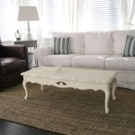 White Slipcovered Sofa With White Long Table And Rug