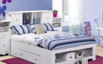 White bed frame with shelf and drawer plus shelves and cabinet in bed headboard