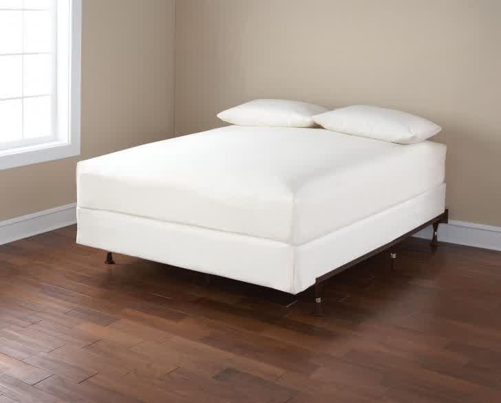 white spring box white bedding a pair of white pillows