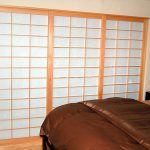 Wood framed shoji screen door idea for bedroom black bedside table with battery powered table lamp brown bedding idea