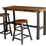 Wood top rectangular pub table with smaller tree trunk legs two units of round wood backless bar stools with smaller tree trunk legs