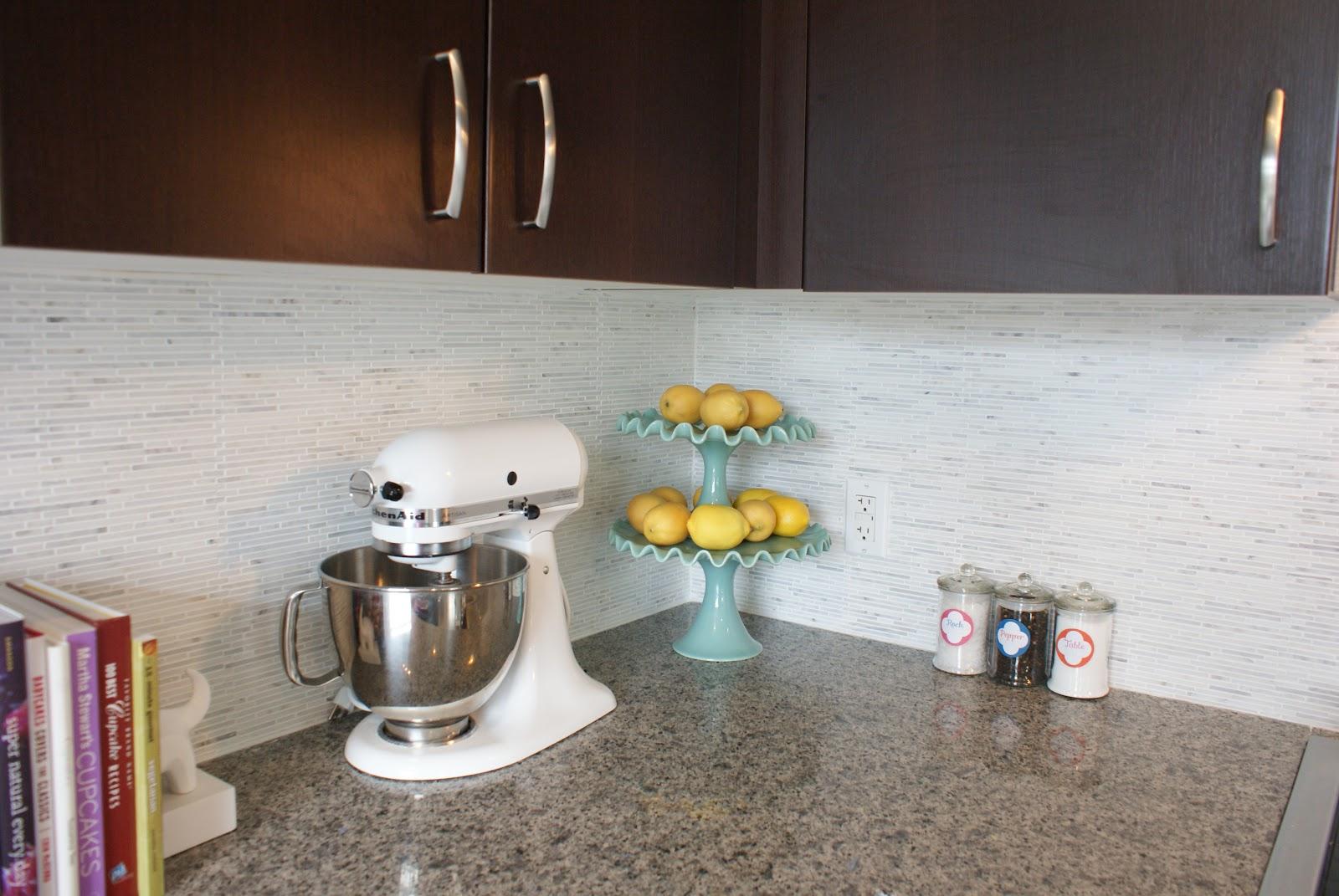 wooden kitchen cabinet with carrar marble backsplash