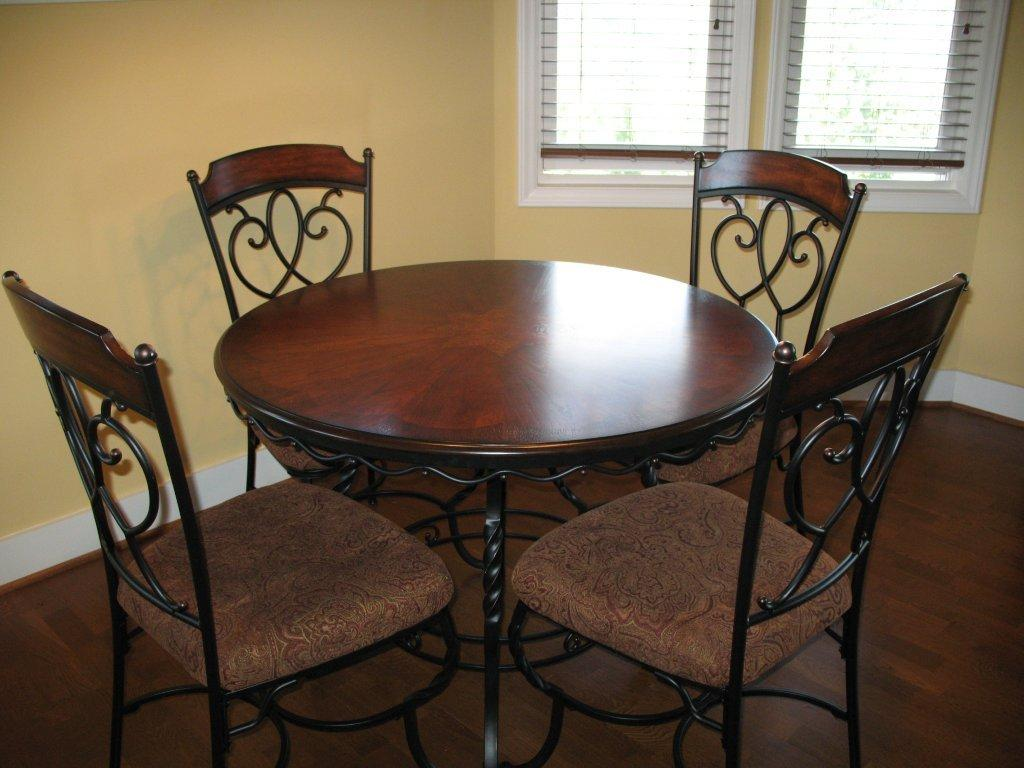 Genial Wooden Round Wrought Iron Kitchen Table With Classic Chairs Style