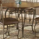 Wooden Top Of Wrought Iron Kitchen Table With Same Design Of Chairs On Cool Rug