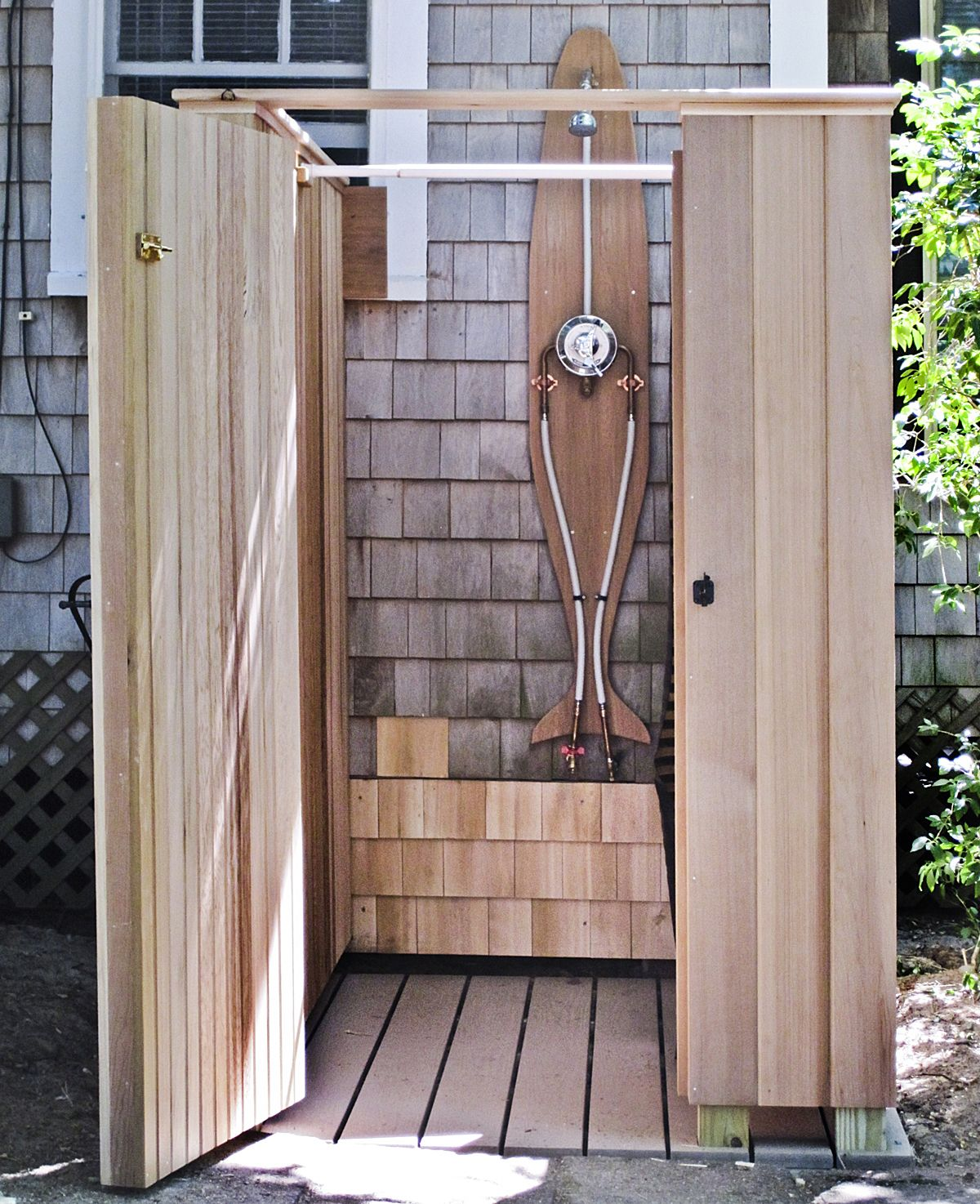 Wooden Outdoor Shower Space In Minimalist Style Presenting Semi Free Standing Showerhead Fixture And Wood Planks