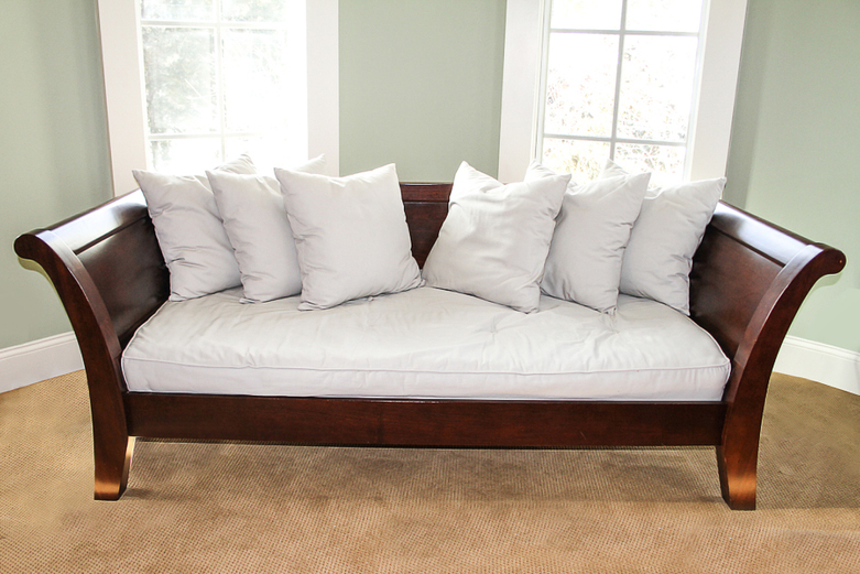 Wooden Pottery Barn Daybed Set With White Bedding And White Accent Pillows