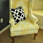 Yellow White Design Pattern Of Upholstered Wingback Chair With Black White Pillow