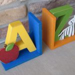 a-handmade-item-of-a-to-z-bookends-for-children-library-and-bookshelf-and-A-with-apple-and-Z-with-zebra-also-design-by-Lisa-Bees-Craft-and-Design-also-materials-are-wood-ribbon-paint