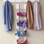 A Smart Entryway For Winter Session Avoid Misplacing Also Using Baskets With Labels To Organize Gloves And Coats And Using The Rails To Hold The Baskets