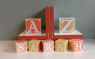 a-to-z-baby-gift-set-coral-and-gold-bookends-with-baby-name-blocks-handmade-by-Decorated-Wood-and-materials-are-maple-pine-mdf-paint-clear-coat-and-vinyl