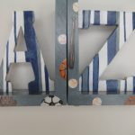 a-to-z-vintage-sport-bookends-with-striped-letters-in-gray-and-navy-handmade-by-the-present-place-with-materials-are-wood-acrylic-paint-paint-pen-and-sealer