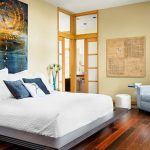 adorable asian bedroom design with navy blue pillow and wooden floor and glass window and white slipcover sofa and wall picture