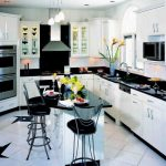 adorable contemporary black and white kitchen decor idea with breakfast nook and black chairs and white black appliance