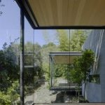 adorable interior design of sillicon valley home with glass sdiding and natural view outside