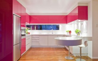 adorable kitchen design with pink cabnet furniture idea and white accent and extended white kitchen bar and indoor plant