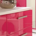 adorable pink furniture in the hallway of dresser with white top and bronze decoration on the top