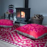 adorable pink moroccan floor cushion idea with ethnic concept on patterned pink area rug with cclassic fireplace and chair