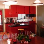 adorable red country kitchen design with storage and red dining table with wooden chairs and pendants and wooden flooring