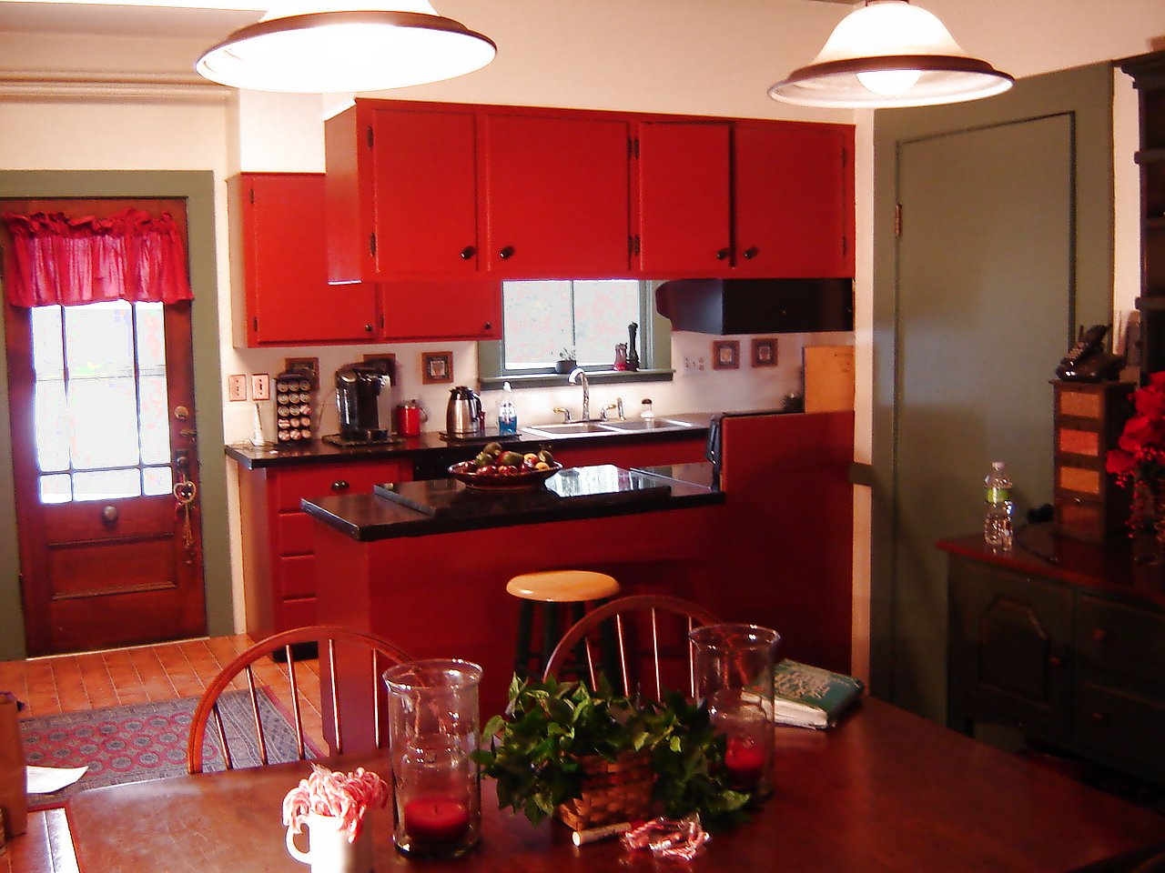 Adorable Red Country Kitchen Design With Storage And Red Dining Table With  Wooden Chairs And Pendants